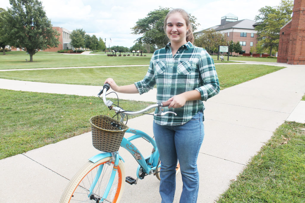 Student with her bicycle